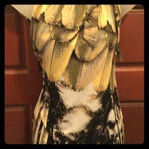 Lovely, flirty and fun sleeveless dressy top.
